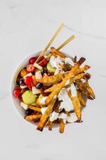 Crispy Greek-style Idaho® Potato Fries with Greek Salad and Tzatziki Sauce