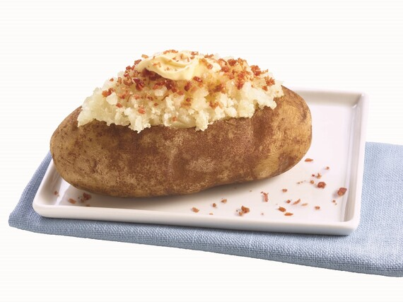 The Ultimate Baked Potato With Butter and Bacon Toppings