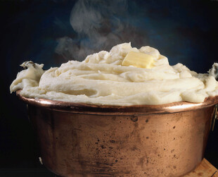 Mashed Potatoes with Butter in a Copper Pot