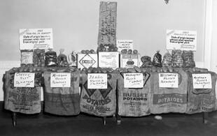 Display of potatoes with burlap bag labels
