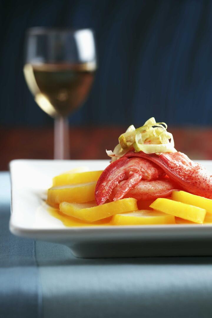 Saffron Scented Potato Medallions with Lobster and Passion Fruit Vinaigrette