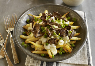 Spring Vegetarian Poutine with Fresh Spring Peas, Black Trumpet Mushrooms and Dill Béchamel