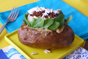 Baked Idaho® Potato with Baby Spinach, Tapenade and Goat Cheese with Pine Nuts