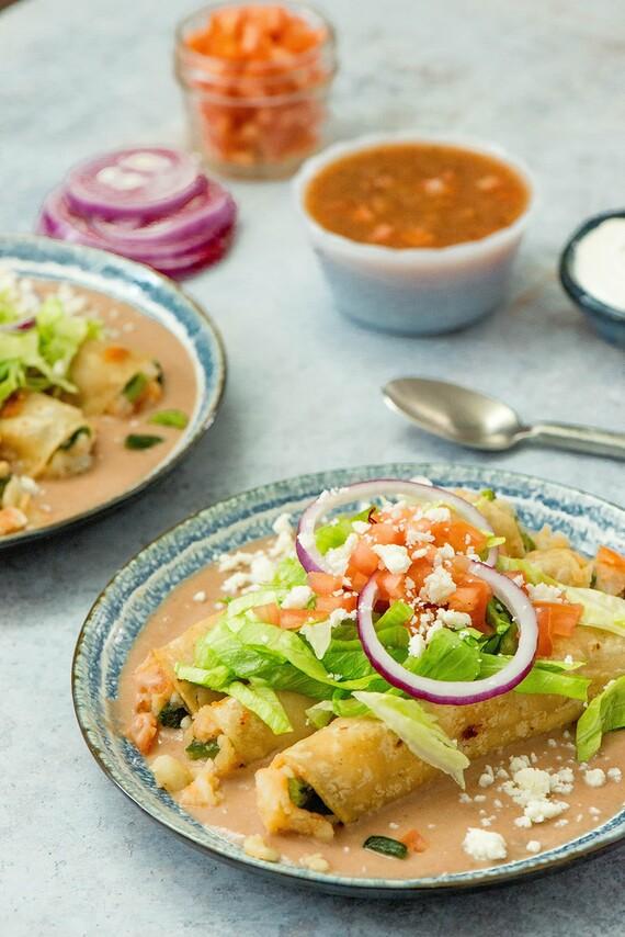 Potato Flautas with Poblano Pepper, Oaxaca Cheese on Bean Purée