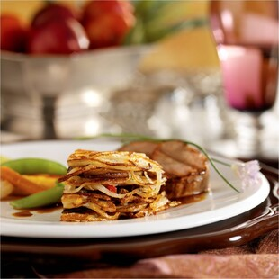 Grilled Veal Loin Medallions with Mushroom and Idaho® Potato Galette and Calvados Veal Reduction