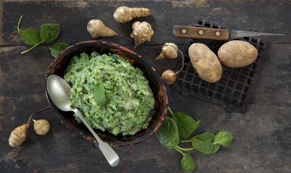 Smashed Idaho® Potatoes with Sunchokes, Roasted Garlic & Spinach