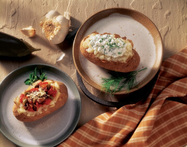 Baked Idaho® Potato with Herbed Cottage Cheese and Baked Idaho® Potato with Eggplant Parmigiana Topping