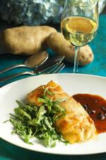 Idaho® Potato Crusted Black Bass with Black Truffle Sauce and Wild Arugula