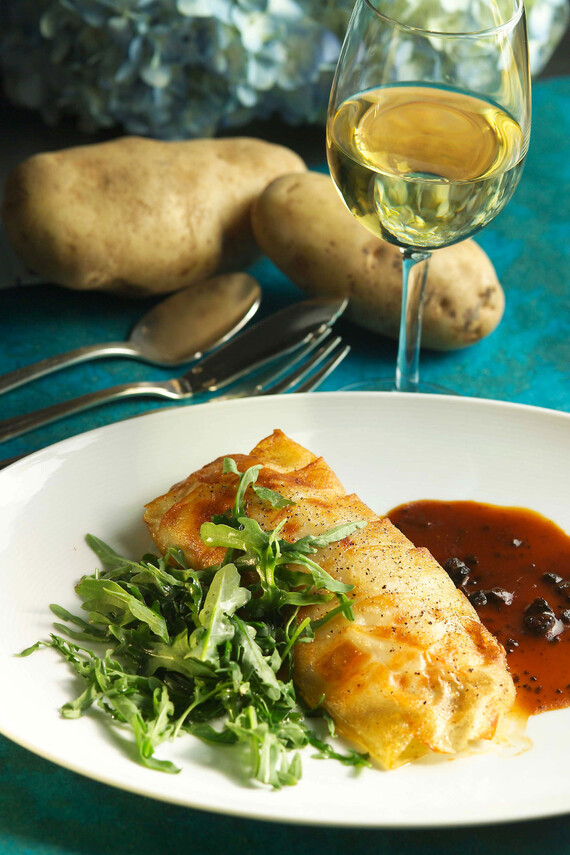 Idaho® Potato Crusted Black Bass with Black Truffle Sauce and Wild Arugula