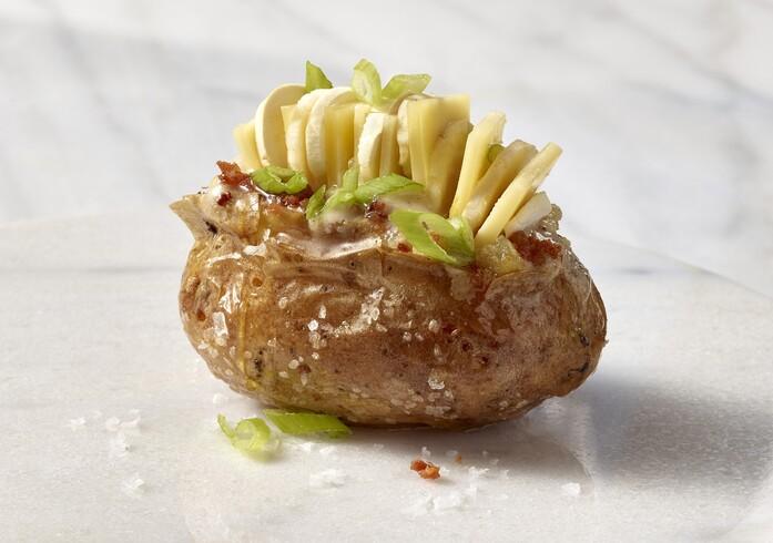 Loaded Baked Idaho® Potato with Mushroom Butter, Truffle Honey, Comté, Benton's Bacon, Scallions