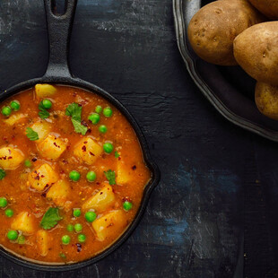 Curried Potatoes and Baby Peas (Tariwale Aloo)