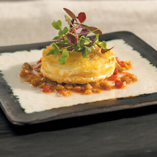 Warm Chèvre and Idaho® Potato Cake with Sun-dried Tomato and Olive Vinaigrette