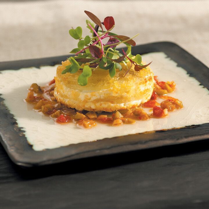 Warm Chèvre and Idaho® Potato Cake with Sun-dried Tomato and Olive Vinaigrette