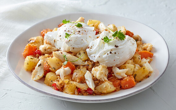Idaho® Potato and Crab Hash with Poached Eggs